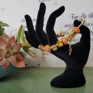 Gold Silver tone orange and yellow charm bracelet